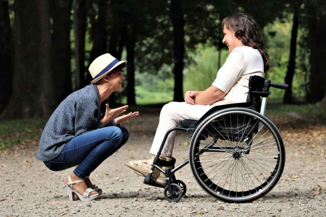 woman on black folding wheelchair